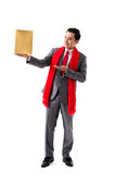 Showing a box. Full-length portrait of smiling man showing golden giftbox Royalty Free Stock Image