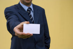 Showing Card 3. Bussinessman showing is blank card (focus on the card Royalty Free Stock Image