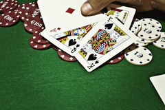 Showing cards green table copyspace stock image