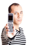 Showing a cellphone Royalty Free Stock Image
