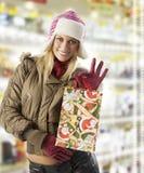 Showing christmas shopping Royalty Free Stock Image