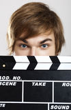 Showing a clapboard Royalty Free Stock Photo