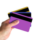 Showing Credit Cards. Hand showing credit cards with white background. Could be business card/credit card stock photos