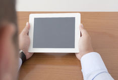 Showing the Digital Tablet on Table Royalty Free Stock Photo