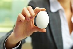 Showing egg Royalty Free Stock Photo