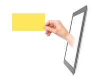 Showing Electronic Business Card. Female hand showing yellow translucent business card from blank digital tablet pc. Isolated on white Stock Photography