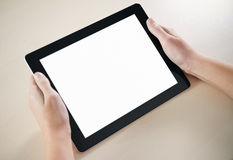Showing Electronic Tablet PC. Woman hands holding electronic tablet pc with blank screen Stock Images