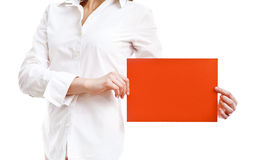 Showing an empty banner. Woman in white shirt showing an empty banner, on white royalty free stock photo