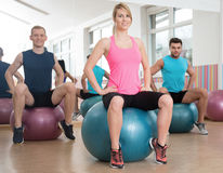 Showing exercise on fitness ball Stock Image