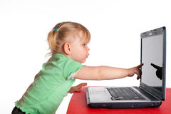 Showing the finger monitor of laptop little girl Stock Image