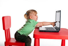 Showing the finger monitor of laptop little girl Royalty Free Stock Image