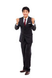 Showing fist young Asian business man. Stock Photo