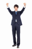Showing fist young Asian business man. Royalty Free Stock Photo