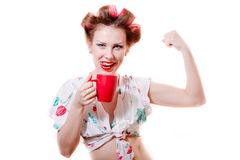 Showing fitness drink: pinup girl with red lips drinking beverage looking at camera & happy smiling on white background Stock Photo