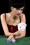 Showing four of a kind. Poker playing showing the dealer her hand of four aces in a poker game Stock Images