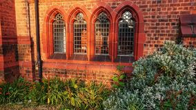 Four old stained glass church windows royalty free stock photo