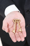 Showing the golden key Royalty Free Stock Image