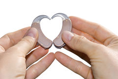 Showing a heart from hearing aids royalty free stock image