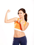 Showing her arm muscle Royalty Free Stock Photo