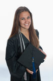 Showing her cap and tassel Stock Images