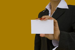 Showing her id. Businesswoman showing a blank card with a colored background (focus on the card Royalty Free Stock Photography