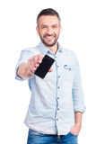 Showing his brand new smart phone. Royalty Free Stock Image