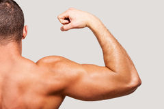 Showing his perfect bicep. Stock Photos