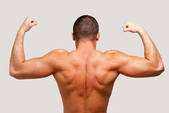 Showing his perfect muscles. Stock Image
