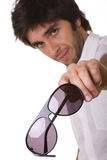 Showing his sunglasses Royalty Free Stock Photos