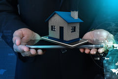 Showing home with smart phone Stock Images