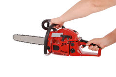 Showing how to work with chainsaw Stock Image