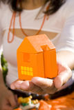 Showing my new house 1. Proudly pretenting my new house  (focus on the house Stock Image