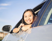 Showing new car keys. Woman  holding car keys driving her new car Stock Photography