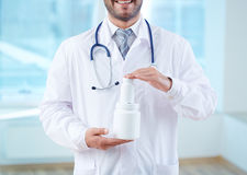 Showing new vitamins Stock Photography