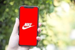 Turkey, Istanbul - September 15.2018: Hands on experience on Nike. Reviewing tNike application. Showing Nike on mobile phone. Depi. Showing Nike on mobile phone stock photo