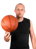 Showing Off. A young man with bright blue eyes and a basketball spinining on his finger! Isolated over white Stock Photo