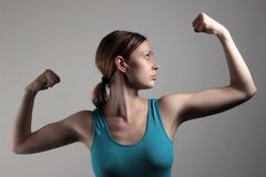 Showing Off Biceps Royalty Free Stock Photography