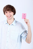 Showing off his driving licence Royalty Free Stock Images