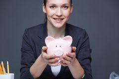 Showing piggy bank Stock Photo