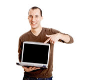 Showing a presentation. Young man showing a work presentation on the laptop, isolated on white Stock Photo