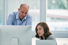 Showing presentation to colleague Stock Image