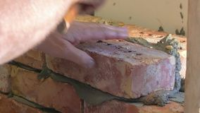 Showing of process brickwork. Close-up stock video footage