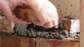 Showing of process brickwork. Using of concrete mortar for masonry bricks stock video footage