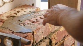 Showing of process brickwork. Using level for masonry bricks stock video
