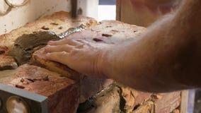 Showing of process brickwork. Using level for masonry bricks stock footage