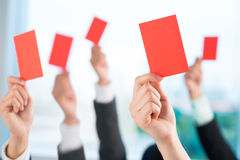 Showing red cards Stock Photo