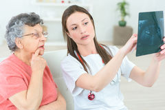 Showing senior patient x-ray stock photo