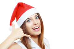 Showing sigh call me. Christmas woman in santa's hat showing sigh call me isolated on white Royalty Free Stock Photo