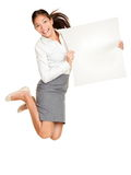 Showing sign woman jumping. Showing sign. Woman jumping holding poster of paper, blank and empty with copy space. Casual business woman jumping excited smiling Royalty Free Stock Photo