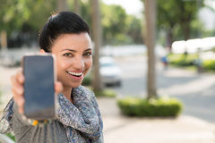 Showing smartphone royalty free stock photography